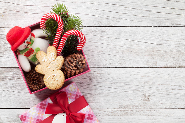 Christmas gift box with gingerbread man, candy canes Stock photo © karandaev