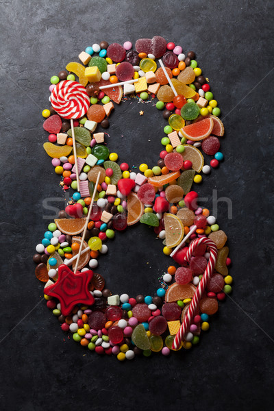 Szám nyolc cukorkák édes sötét üdvözlőlap Stock fotó © karandaev