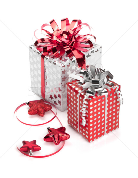 Two red and silver gift boxes with ribbons and christmas decor Stock photo © karandaev