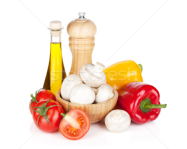 Fresh vegetables and mushrooms with olive oil and pepper shaker Stock photo © karandaev