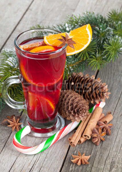 Christmas mulled wine with spices and snowy fir tree Stock photo © karandaev
