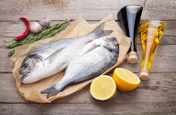 Fresh dorado fish cooking with spices and condiments Stock photo © karandaev