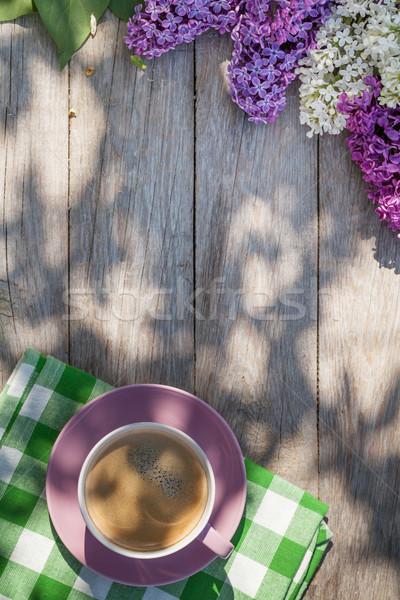Filiżankę kawy kolorowy liliowy kwiaty ogród tabeli Zdjęcia stock © karandaev