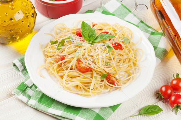 Spagetti makarna beyaz şarap domates fesleğen ahşap masa Stok fotoğraf © karandaev