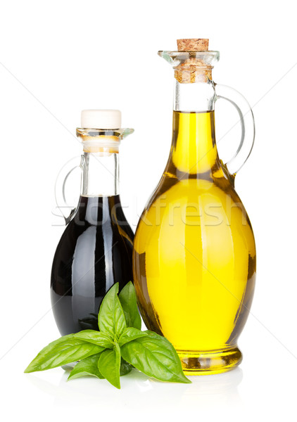 Olio d'oliva aceto bottiglie basilico isolato bianco Foto d'archivio © karandaev