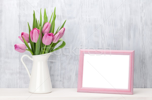 Fresh pink tulips bouquet and photo frame Stock photo © karandaev