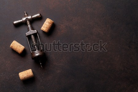 Vintage corkscrew and wine corks Stock photo © karandaev