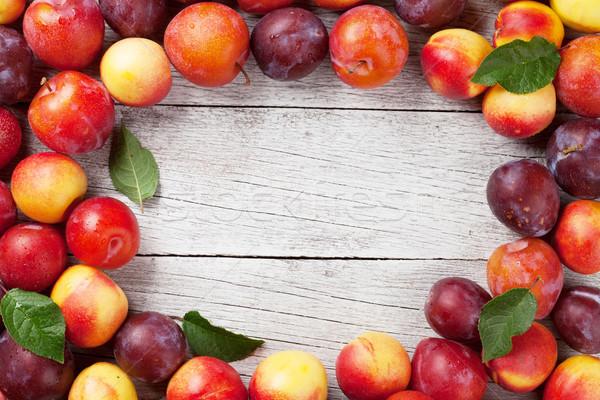 Fresh ripe peaches and plums Stock photo © karandaev