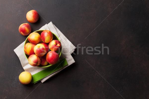 свежие зрелый персики каменные таблице Top Сток-фото © karandaev
