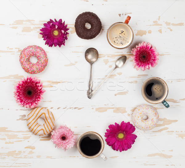 Coffee cup, donuts and gerbera flowers clock Stock photo © karandaev