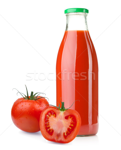 Bottle of tomato juice and ripe tomatoes Stock photo © karandaev