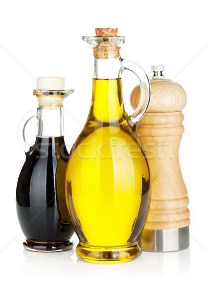 Olio d'oliva aceto bottiglie pepe shaker isolato Foto d'archivio © karandaev