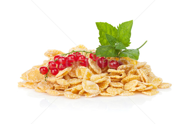 Fresh corn flakes heap with berries Stock photo © karandaev