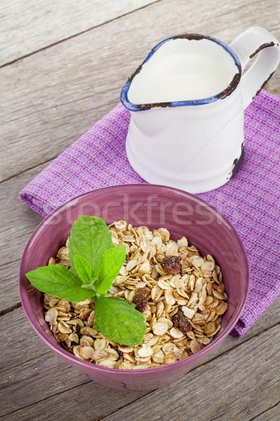 Sağlıklı kahvaltı müsli süt ahşap masa ahşap Stok fotoğraf © karandaev