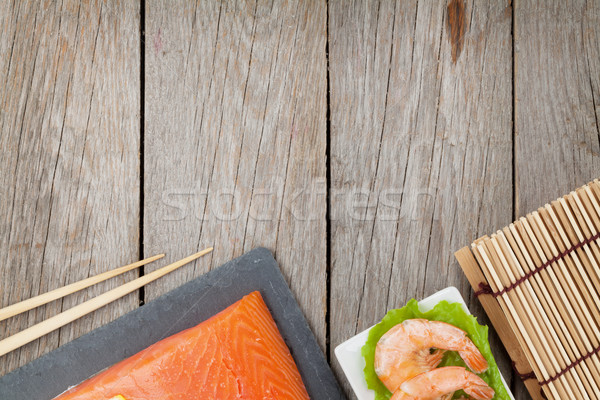 Stock photo: Fresh sea food and kitchen utensils