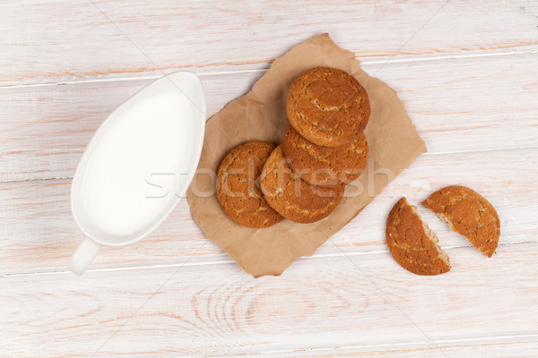 Stock photo: Milk pitcher and gingerbread cookies