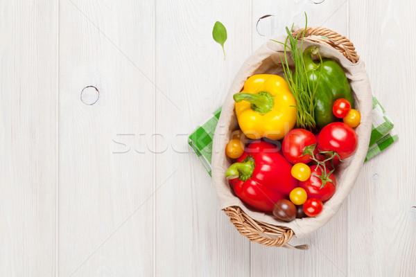 Légumes frais panier table en bois haut vue espace de copie Photo stock © karandaev