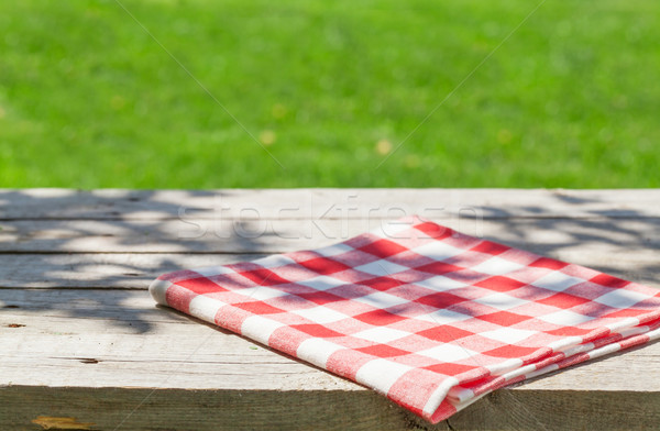 Empty wooden garden table with tablecloth Stock photo © karandaev