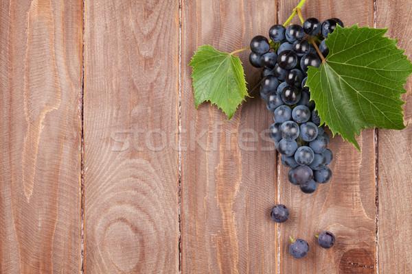 Red grape on wooden table Stock photo © karandaev