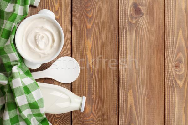 Ekşi krema çanak süt şişe ahşap masa üst Stok fotoğraf © karandaev
