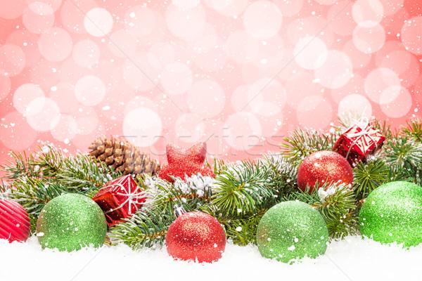 Christmas tree and bauble decor on snow Stock photo © karandaev