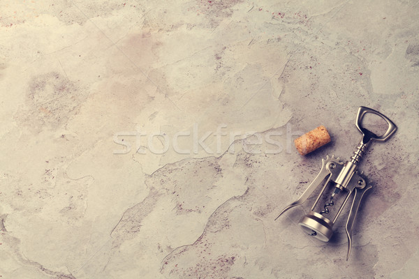 Corkscrew and cork on stone table Stock photo © karandaev