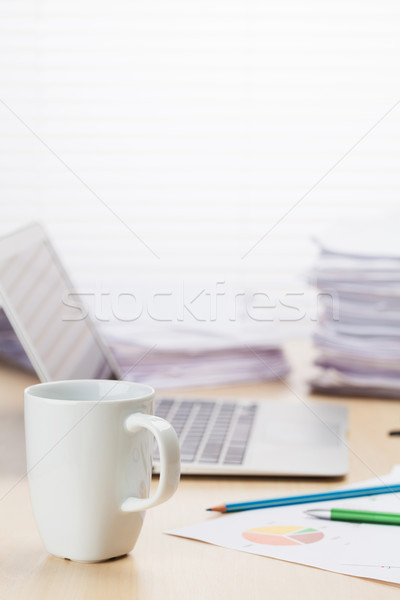 Office workplace with coffee, laptop and supplies Stock photo © karandaev