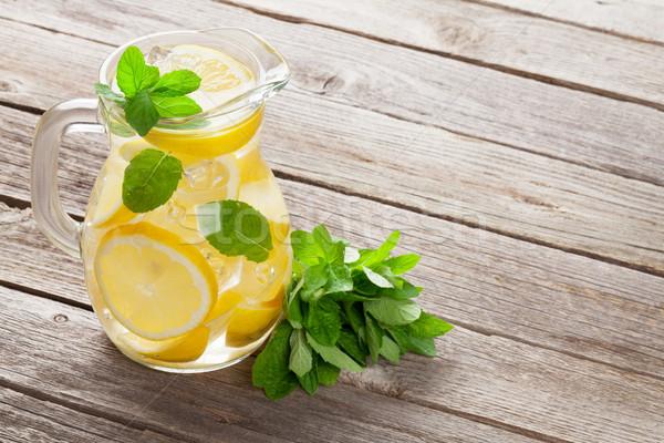 Limonádé citrom menta jég kert asztal Stock fotó © karandaev
