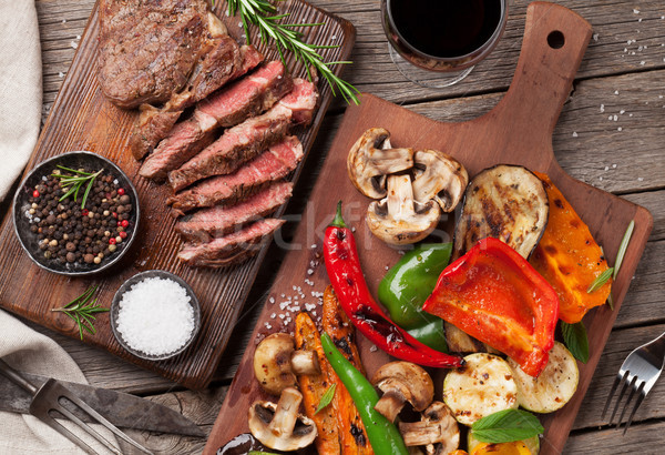 Grilled vegetables and beef steak on cutting board Stock photo © karandaev