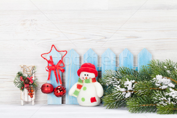 Christmas snowman and sledge toys and fir tree branch Stock photo © karandaev
