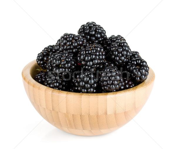 Blackberry in wooden bowl Stock photo © karandaev