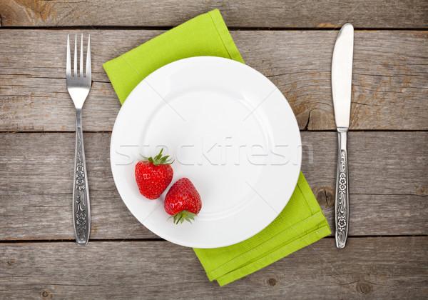 Tányér érett eper ezüst étkészlet öreg fa asztal Stock fotó © karandaev