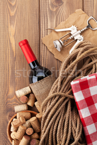 Stock photo: Red wine bottle, corks and corkscrew