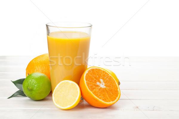 Suco de laranja cítrico frutas branco mesa de madeira madeira Foto stock © karandaev
