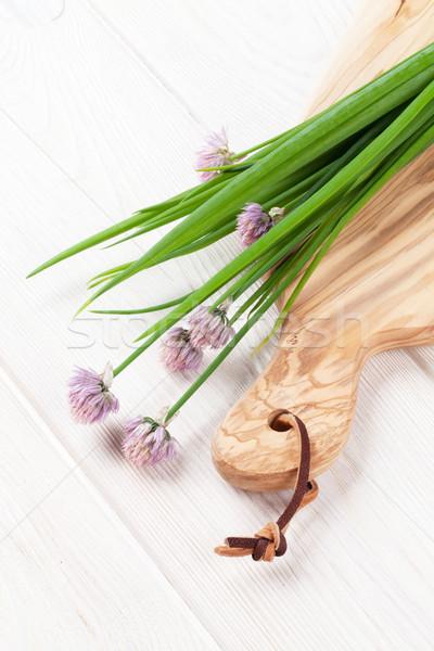 Fresh spring onion on cutting board Stock photo © karandaev