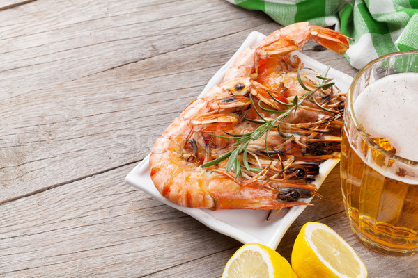 Beer mug and grilled shrimps Stock photo © karandaev
