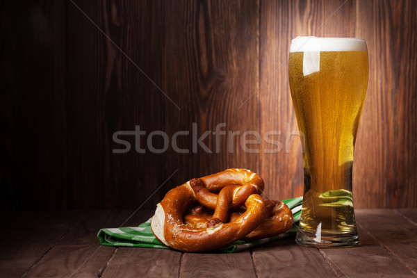 Lager beer glass and pretzel Stock photo © karandaev