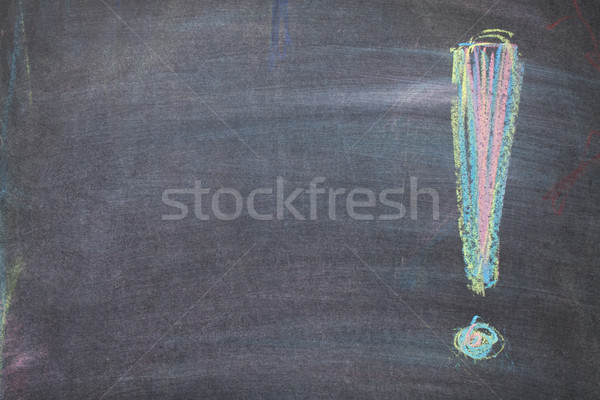 Colorful chalk exclamation mark on blackboard background Stock photo © karandaev