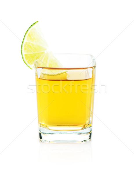Shot of gold tequila with lime slice Stock photo © karandaev