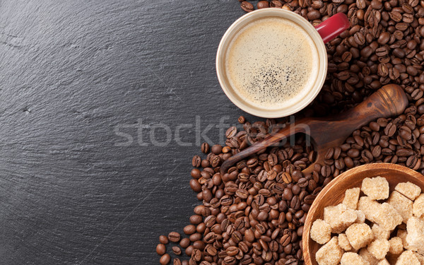 Coffee cup, beans and brown sugar on stone table Stock photo © karandaev
