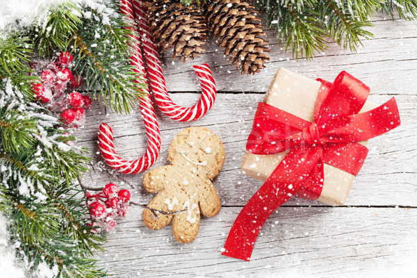 Stock photo: Christmas gift, gingerbread man, candy canes and fir tree