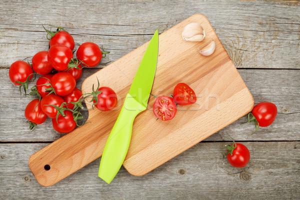 помидоры черри деревянный стол ножом разделочная доска древесины лист Сток-фото © karandaev