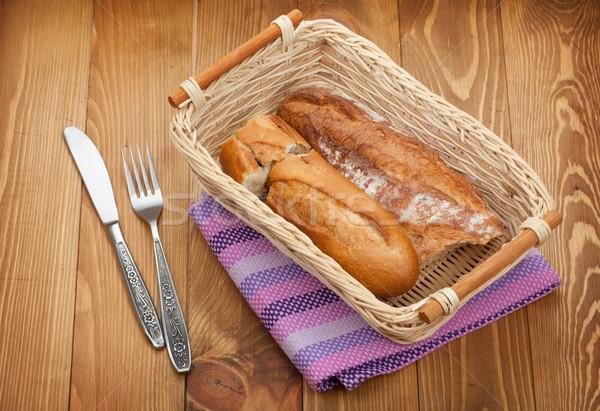 Házi készítésű francia kenyér fa asztal étel fa asztal Stock fotó © karandaev