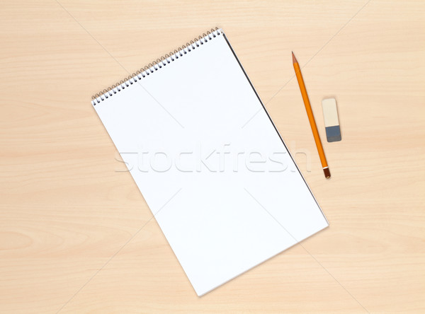 Blank notepad, pencil and eraser on the wooden table Stock photo © karandaev