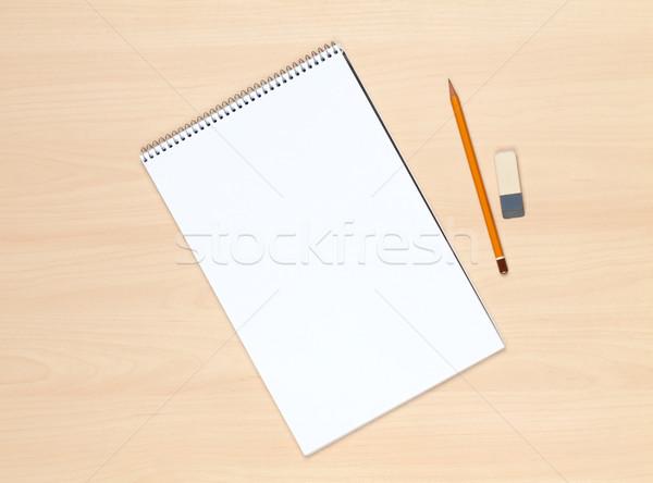 Notepad matita eraser tavolo in legno casa Foto d'archivio © karandaev