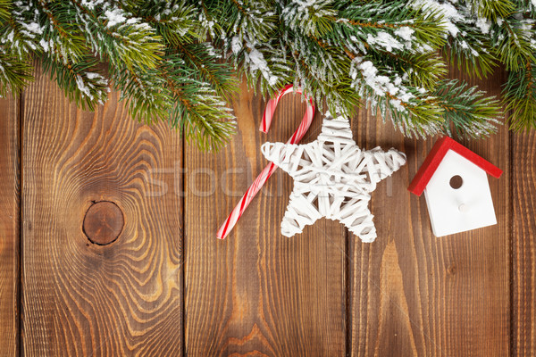 Snow fir tree and christmas decor Stock photo © karandaev