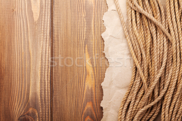 Wooden background with marine rope Stock photo © karandaev