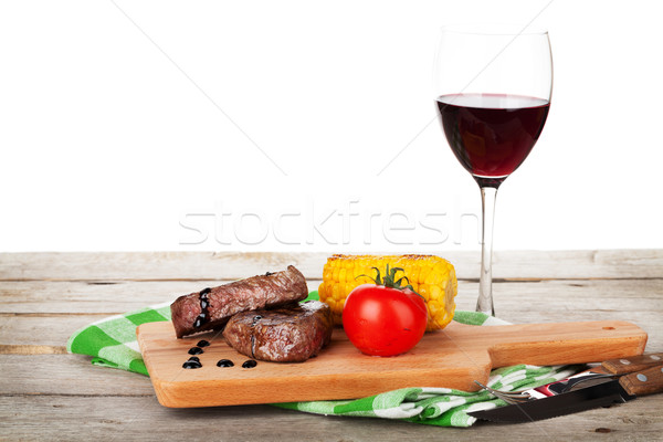 Steak with grilled corn, tomato and red wine Stock photo © karandaev
