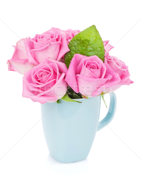 Small pink rose flowers bouquet in tea cup Stock photo © karandaev