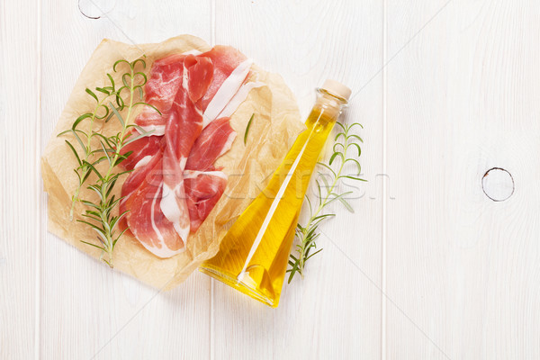 Stock photo: Prosciutto with rosemary and olive oil
